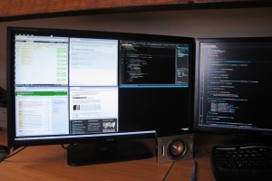 A photograph of the 4K screen with four browser windows and Visual Studio open.
